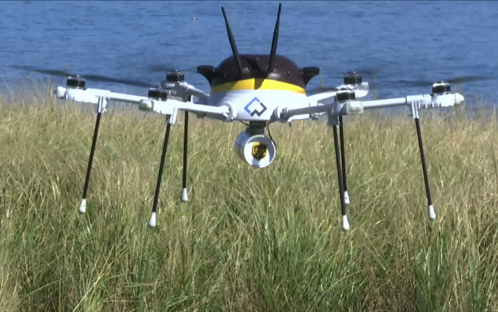 A UPS test drone lands Thursday on Children's Island off Massachusetts. UPS partnered with robot-maker CyPhy Works to fly the drone on a programmed route for 3 miles over the Atlantic Ocean to make the mock delivery of an asthma inhaler.