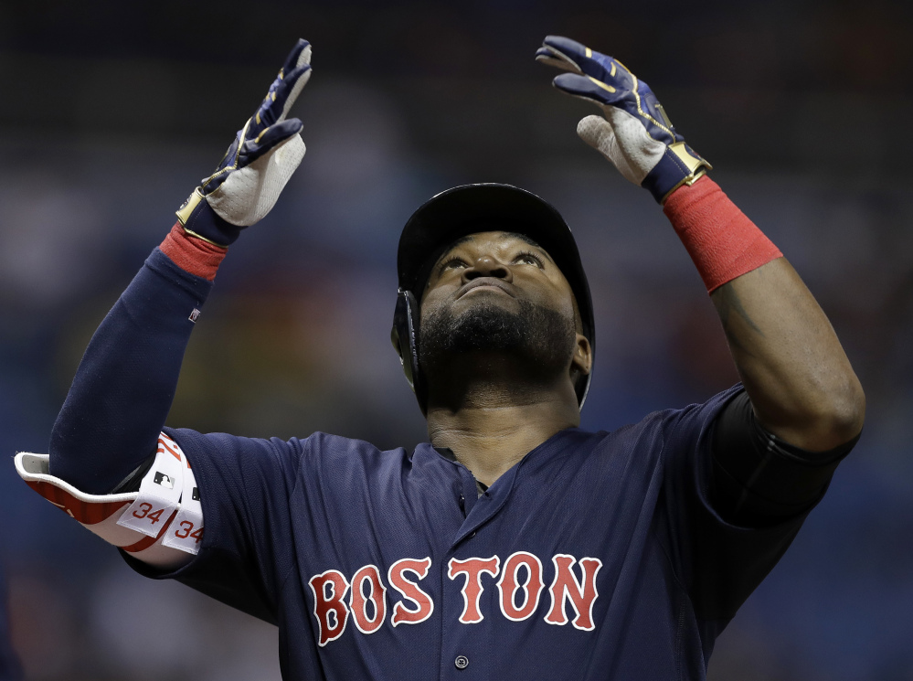 David Ortiz reacts after his two-run home run off Tampa Bay starter Chris Archer in the first inning Friday night in St. Petersburg, Fla.