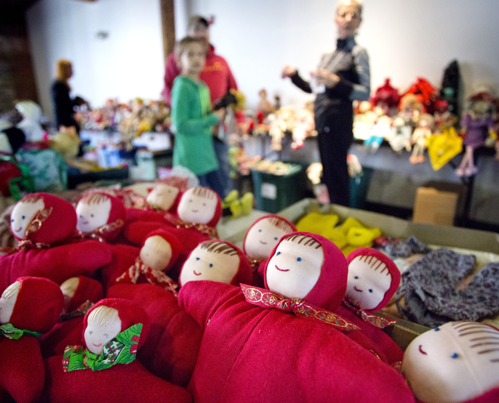 Dolls donated by Bertha Chasse are popular items during a sale at Museum L-A in Lewiston on Saturday, as were nostalgic items like coat hooks from a former school.