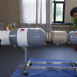 A visitor looks at a replica of China's first space station in Beijing in 2012. Most of the Tiangong 1 is expected to burn up during re-entry in late 2017, a Chinese official says.