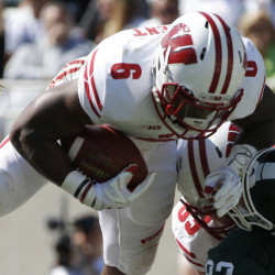 Corey Clement of Wisconsin dives over the line Saturday, scoring one of his two touchdowns that helped the 11th-ranked Badgers humble eighth-ranked Michigan State 30-6 in an early-season Big Ten showdown at East Lansing, Michigan.