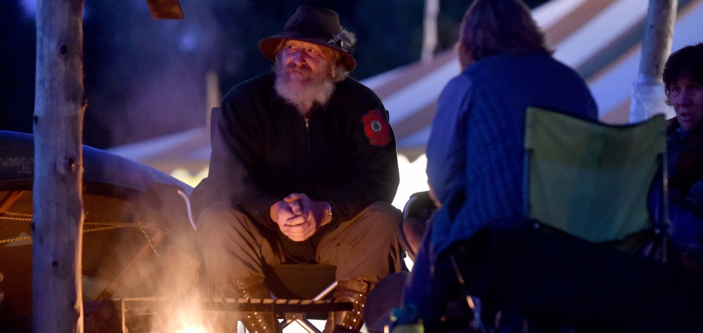 Jeff DeHart, owner of Bear and Otter Guide Services in West Gardiner, sits in his camp at the Common Ground Country Fair.