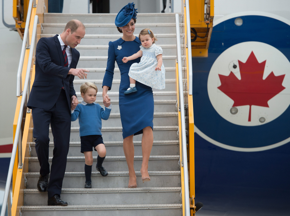 Britain's Prince William and his wife, Kate – the Duke and Duchess of Cambridge – with their children Prince George and Princess Charlotte arrive Saturday in Victoria, British Columbia.
