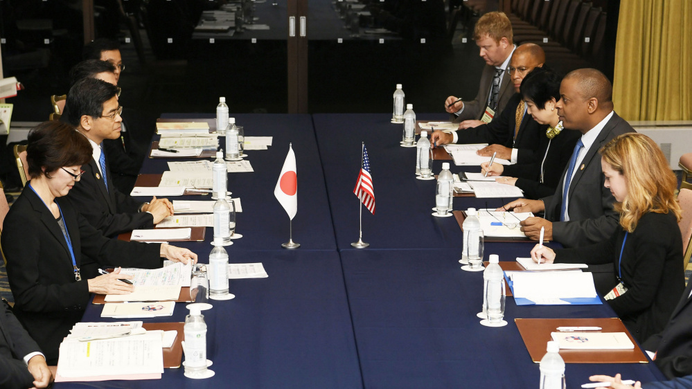 U.S. Transportation Secretary Anthony Foxx, second right, talks Friday with Japan's Land, Infrastructure, Transport and Tourism Minister Keiichi Ishii, second left, during their meeting held on the sidelines of G7 Transport Ministers' meeting in Karuizawa, Nagano Prefecture, north of Tokyo. Foxx says his counterpart ministers from the Group of Seven nations welcomed the new U.S. guidelines on regulating self-driving cars at a weekend meeting in Japan, and they agreed to work together to maintain safety.