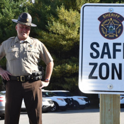 "Franklin County Sheriff Scott Nichols stands in the safe zone in Farmington on Thursday. ""This keeps everyone on their best behavior,"" he said."