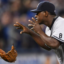 New York pitcher Luis Severino drops his glove as he approaches Toronto's Justin Smoak after hitting him with a pitch and setting off a melee during Monday's game at Toronto.