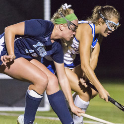 FALMOUTH, ME - SEPTEMBER 26: Field hockey: York sophomore Emlyn Patry duels for the ball with Falmouth senior Mary Burdi. (Photo by)