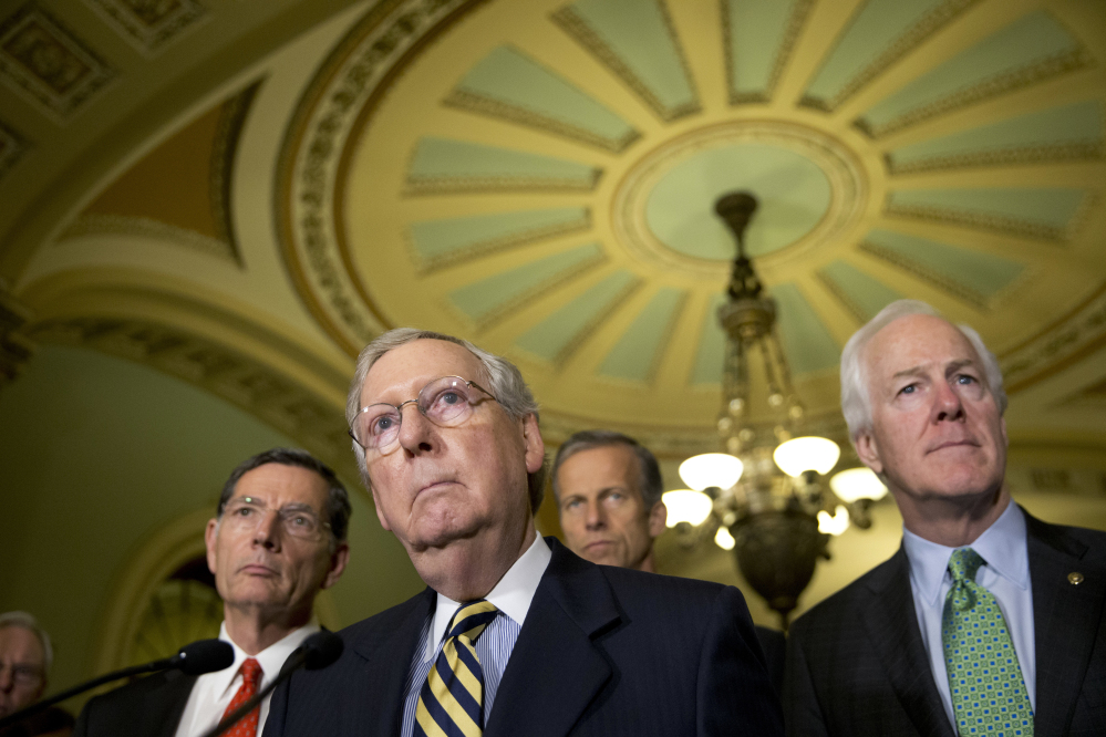 Senate Majority Leader Mitch McConnell of Ky., accompanied by, from left, Sen. John Barrasso, R-Wyo., Sen. John Thune, R-S.D., and Senate Majority Whip John Cornyn of Texas, listen to a question during a news conference on Capitol Hill in Washington. Democrats hope that Republicans will relent and provide money to help Flint, Mich., with its water crisis – and get Capitol Hill off a collision course that could lead to a government shutdown this weekend.