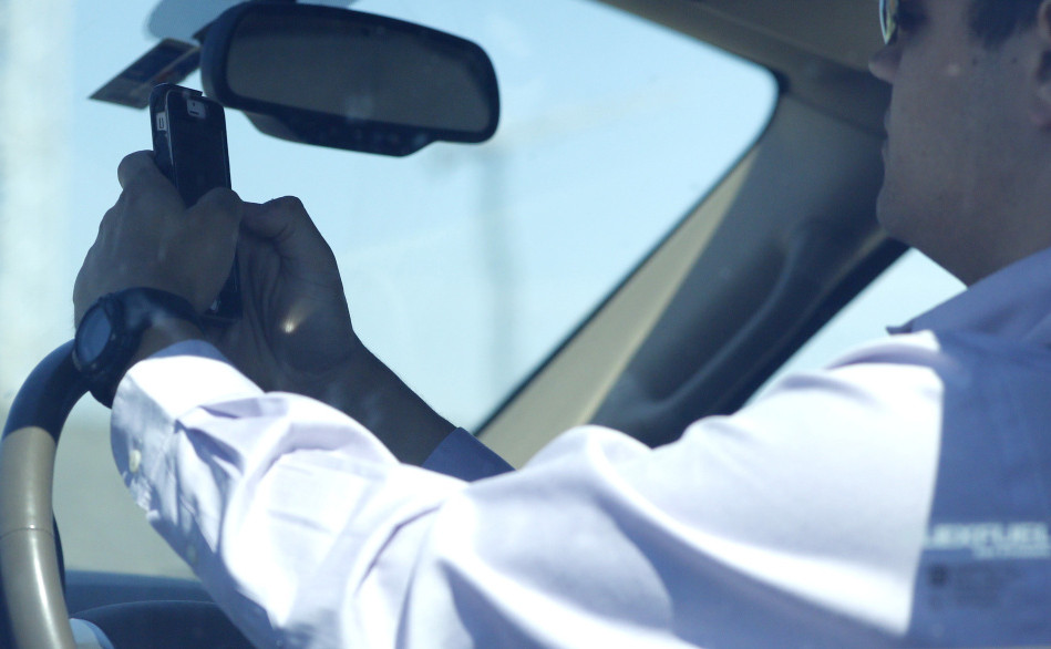 A 2011 state law imposes fines and license suspensions on drivers caught texting. Rep. Stephen Stanley, D-Medway, says the penalties aren't tough enough.