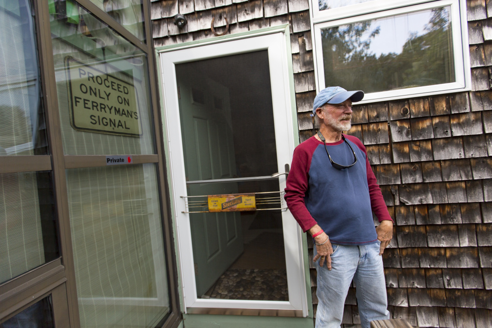 """Summertime resident Skip Davis, who lives next door to the site of the proposed condos, says 14 units would be """"a tough pill for the island to swallow."""" Ben McCanna/Staff Photographer"""
