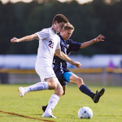 Greely's Jack Saffian fights for the ball against York's Alex Nickerson in Tuesday night's boys' soccer game at Cumberland. Nickerson had a goal in York's 3-0 win.