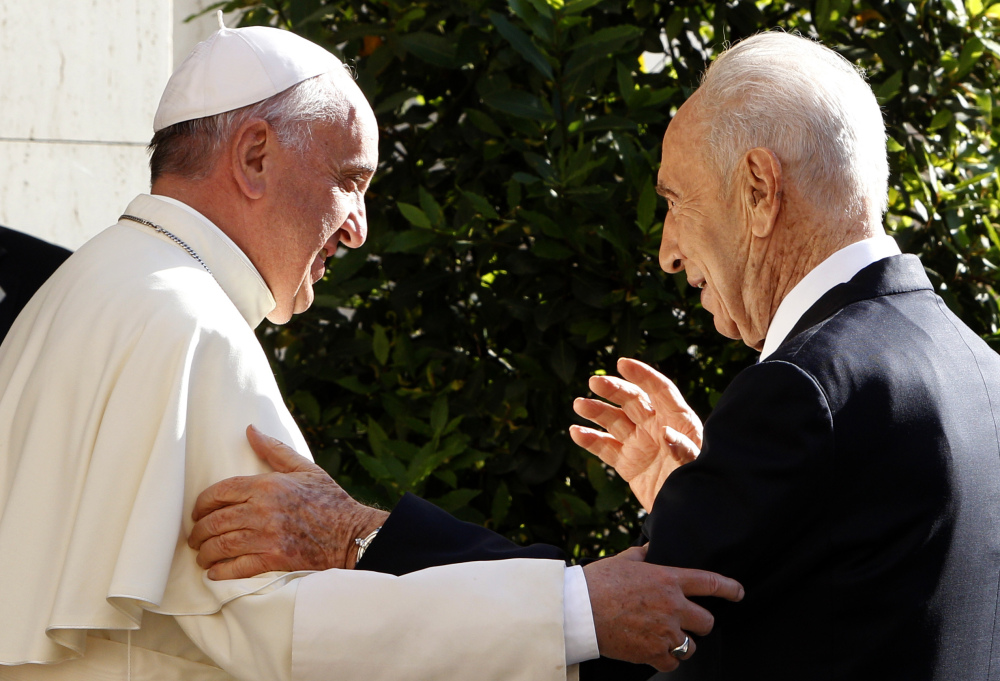 Pope Francis welcomes Israeli President Shimon Peres, right, upon his arrival at the Vatican in 2014. Israel's Foreign Ministry says a long list of world leaders will attend Shimon Peres' funeral on Friday. Spokesman Emmanuel Nahshon said Wednesday that President Obama, Bill and Hillary Clinton, Pope Francis, Prince Charles and Canadian Prime Minister Justin Trudeau are all expected.