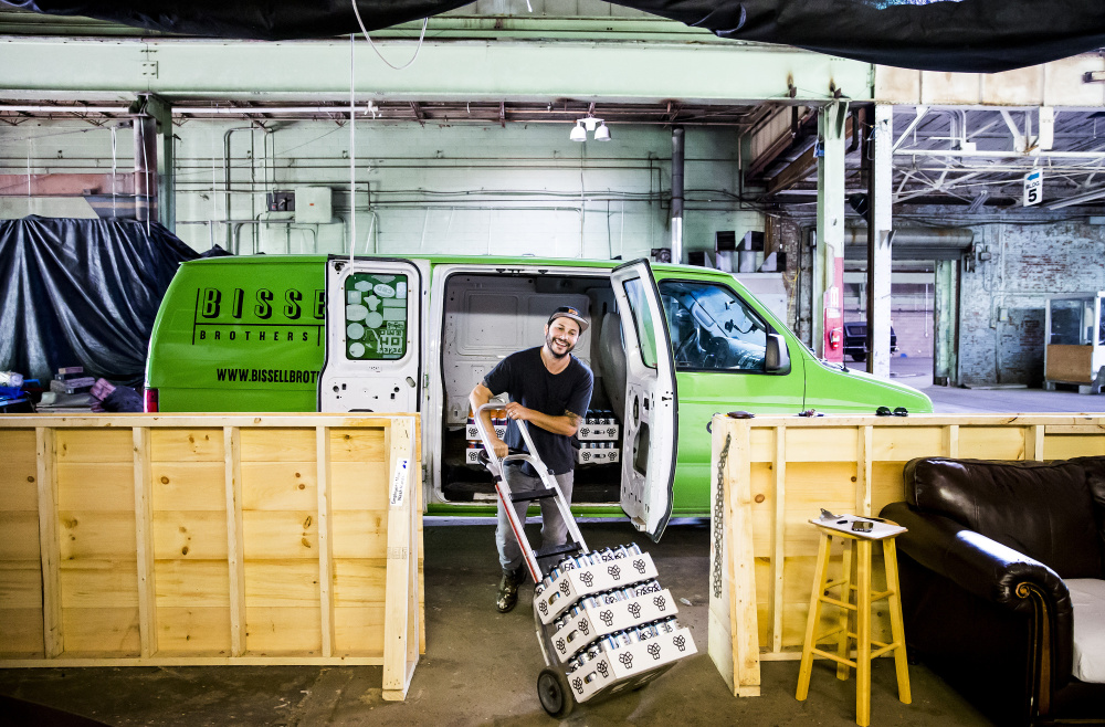 Josh Schlesinger, owner of Sleek Machine Distro, loads his distribution van last month with Bissell Brothers beer for delivery to Ohno Cafe and the Bier Cellar on Forest Avenue in Portland. His one client, which opened in 2013, is one of the hottest brewers in Maine.