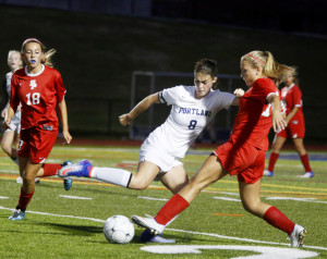PORTLAND, ME - SEPTEMBER 28: South Portland vs Portland girls soccer. Kate Johnson of Portland tries to turn on the ball as Callie O'Brien of South Portland defends during the second half. (Photo by Derek Davis/Staff Photographer)
