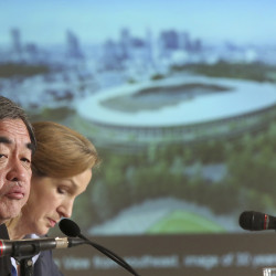 Japanese architect Kengo Kuma, second left, speaks about his design of the 2020 Tokyo Olympic stadium during January a press conference in Tokyo. A Tokyo government panel is set to propose moving more venues outside of the city — including hundreds of kilometers (miles) away — in order to save money, the latest in a series of changes since the Japanese capital was awarded the games three years ago.