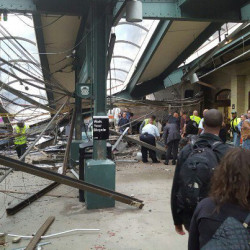 A commuter train barreled into the New Jersey rail station during the Thursday morning rush hour, causing serious damage. The train came to a halt in a covered area between the station's indoor waiting area and the platform. A metal structure covering the area collapsed.