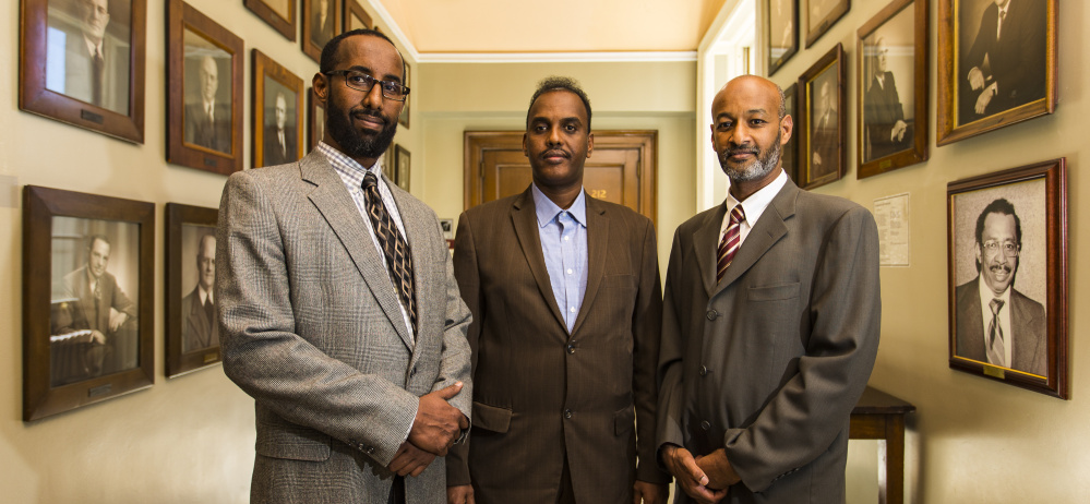 Leaders in the immigrant community gather at Portland City Hall after announcing the formation of the New Mainers Alliance. From left are Mahmoud Hassan, president of the Somali Community Center of Maine, Abdifatah Ahmed, chairman of the New Mainers Alliance, and Elmuatz Abdelrahim, co-founder of the alliance.