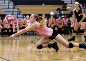 Kacey Foerster of Scarborough dives to keep the ball alive during Thursday's volleyball match against Falmouth. The teams wore pink jerseys to support Scarborough High School's Pink Ribbon Club and its fight against breast cancer.