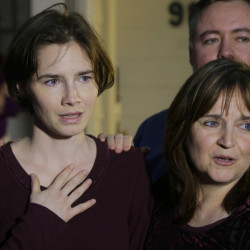 Amanda Knox, left, stands with her mother, Edda Mellas, as she talks to media in Seattle in 2015. Knox spent four years in jail before her conviction was overturned. Associated Press/ Ted S. Warren
