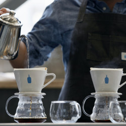 A barista brews coffee at a Blue Bottle Coffee shop in Tokyo. A study examined caffeine intake among women age 65 and older.