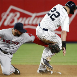 Boston's Deven Marrero applies a late tag on New York's Jacoby Ellsbury, who stole second in the first inning Thursday night in New York.