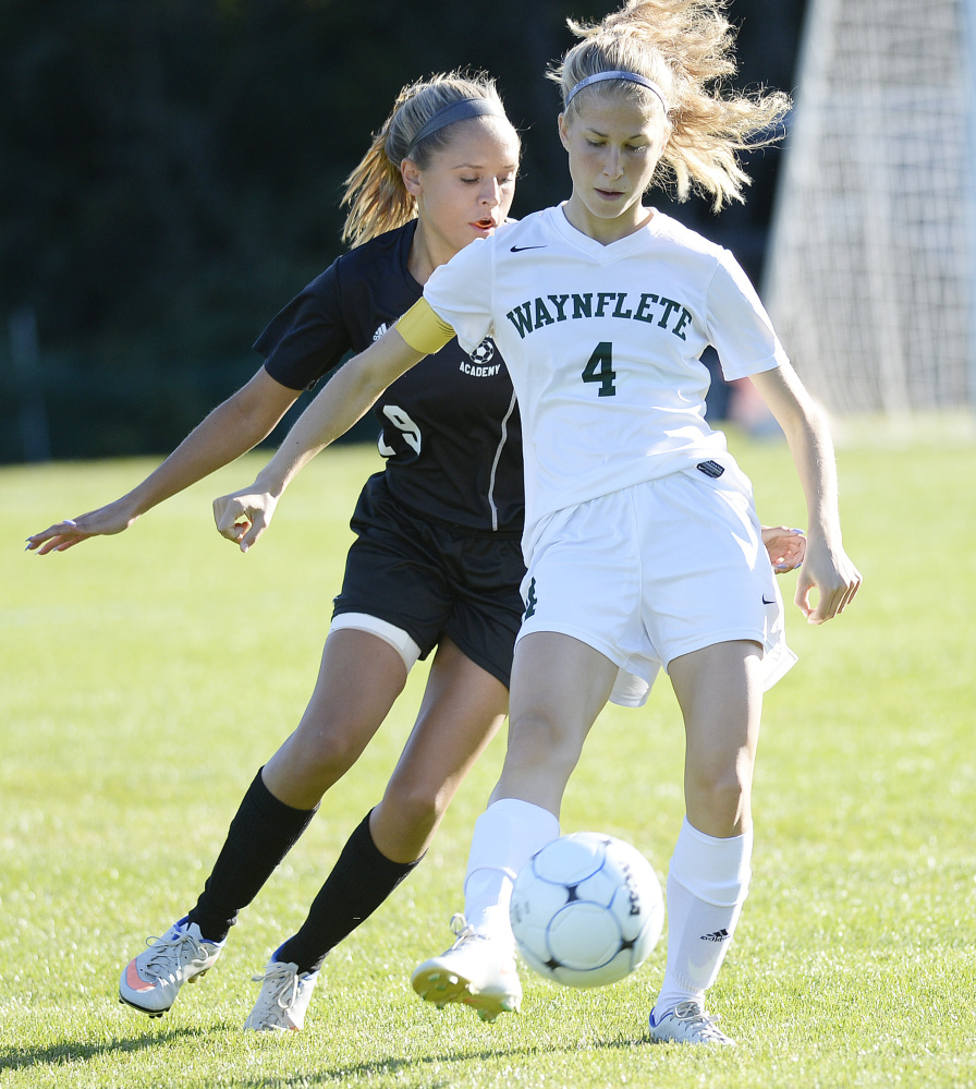 Waynflete's Elisabeth Lualdi tries to keep the ball from Madison Samson of St. Dominic during a girls' soccer game in Portland on Thursday. The Flyers won 3-0. Shawn Patrick Ouellette/Staff Photographer