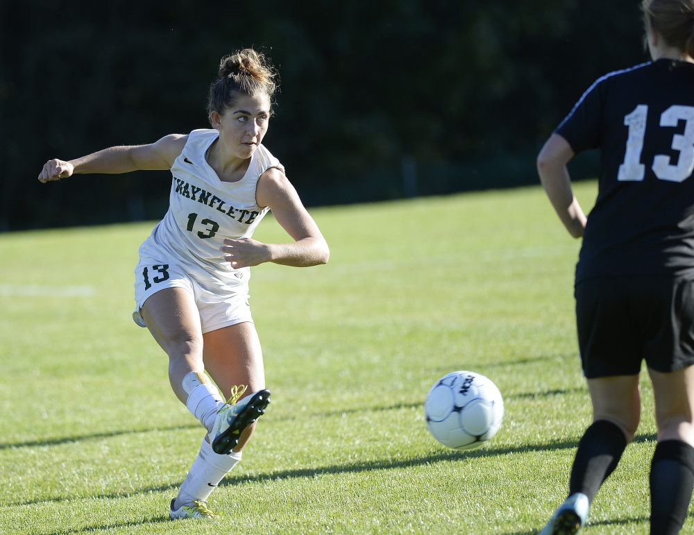 Waynflete's Amelia Bertaska sends the ball up the field during Thursday's game in Portland. Bertaska scored one of the Flyers' three second-half goals. Shawn Patrick Ouellette/Staff Photographer