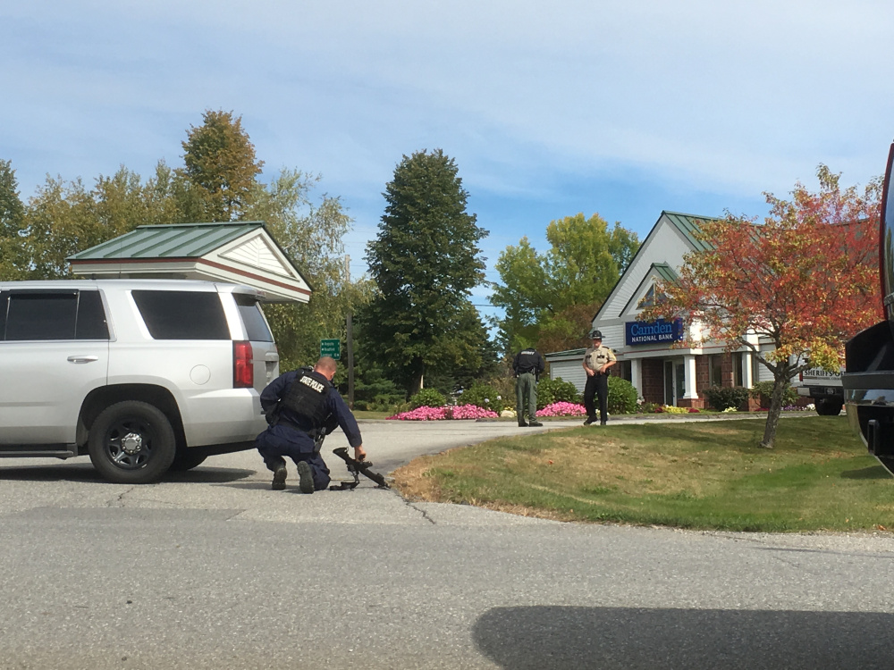 Police respond to the Camden National Bank branch in Manchester after a reported robbery there Friday.