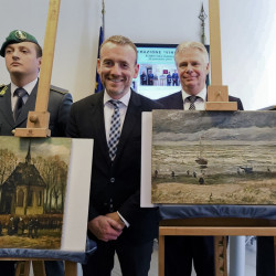 "Director of Amsterdam's Van Gogh Museum Axel Rueger, center, stands next to the paintings ""Congregation leaving the Reformed Church of Nuenen,"" left, and the 1882 ""Seascape at Scheveningen"" by Vincent Van Gogh, during a news conference in Naples, Italy, on Friday. The paintings were stolen from the museum in 2002."