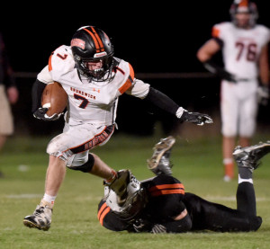 Brunswick's Jesse Devereaux evades Skowhegan defender Devin Dressler during their Class B North football game Friday night in Skowhegan. Devereaux rushed for 171 yards and two touchdowns in a 65-42 win.