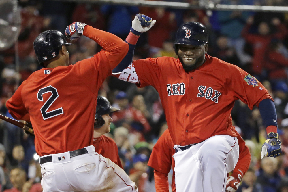 David Ortiz celebrates his two-run home run with Xander Bogaerts in the seventh inning Friday night at Fenway Park.