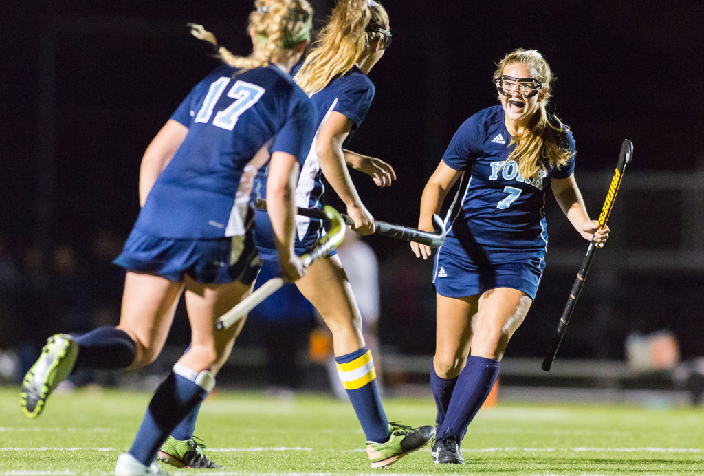 York's Emlyn Patry (17) and Sydney Bouchard (7) congratulate Alexandra Lawlor after her goal against Falmouth.