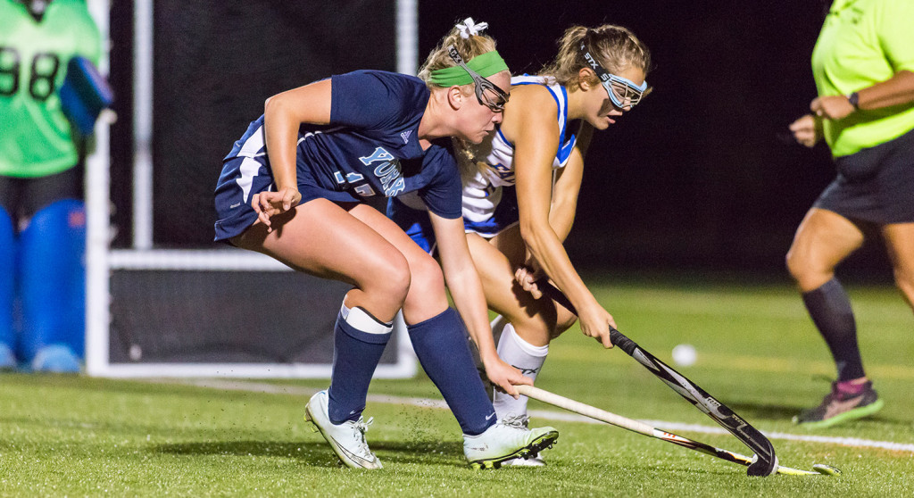York sophomore Emlyn Patry and Falmouth senior Mary Burdi fight for the ball.