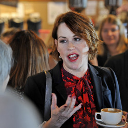 Actress Molly Ringwald talks with Hillary Clinton supporters at Arabica Coffee House on Commercial Street in Portland Tuesday. She says Clinton is 'a great example for me as a woman, for my kids, for my two girls and for my son.'