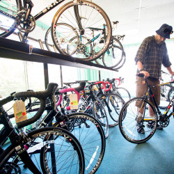 Tobias English of Portland looks at a bike Tuesday at Back Bay Bicycle. So many customers have come in for the store's liquidation sale that owner Cheryl Oliver isn't sure the inventory will last until the end of this month. Derek Davis/Staff Photographer