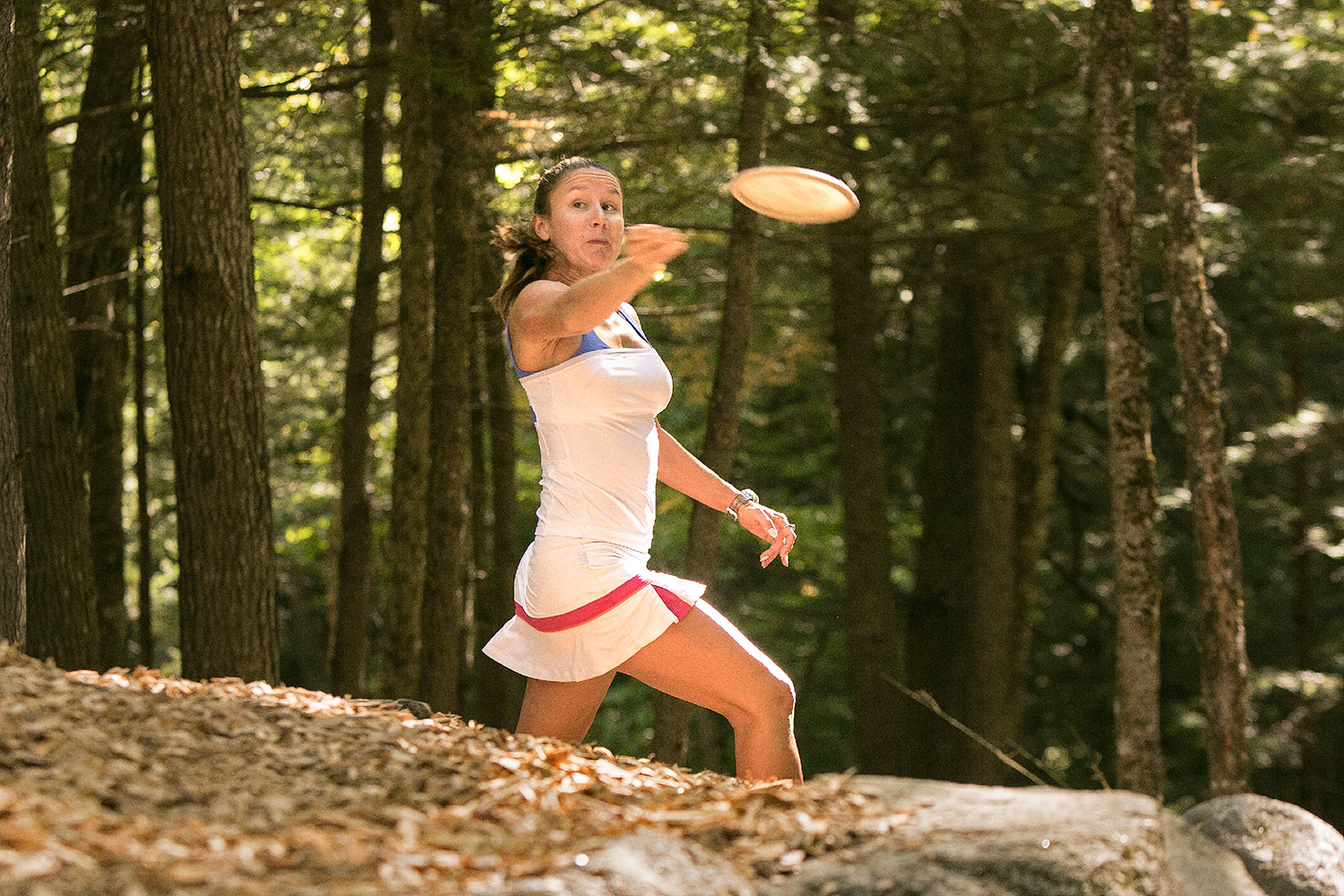 Lizbeth Besok of Florida releases a disc while practicing on a course at the Sabattus Disc Golf Complex. Gregory Rec/Staff Photographer
