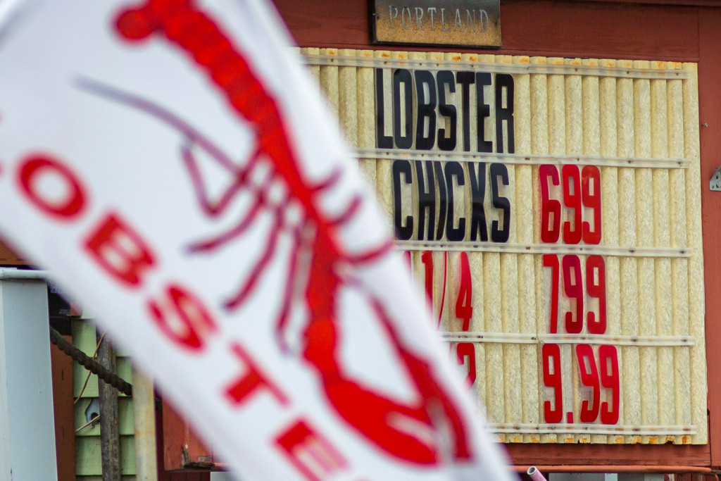 Lobster prices are posted outside Live Lobster Co., a seafood stand on Commercial Street in Portland. Lobster prices are the highest they have been in more than a decade.  Ben McCanna/Staff Photographer