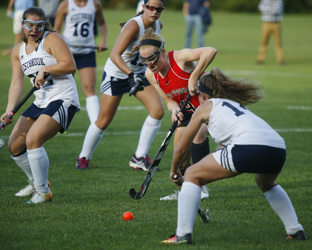 Liz Callahan of Scarborough tries to push the ball past Mary Keef of Westbrook as Kallie Cyr of Westbrook, left, gives help.    Derek Davis/Staff Photographer