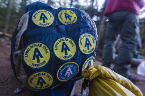 Cornelius Rumblejunk's backpack is festooned with patches for completing segments of the Appalachian Trail on his way to Mt. Katahdin. Rumblejunk began his hike on March 13. Ben McCanna/Staff Photographer
