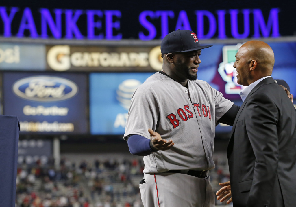 David Ortiz, left, chats with retired Yankees' relief pitcher Mariano Rivera during a pregame ceremony. Associated Press/Kathy Willens