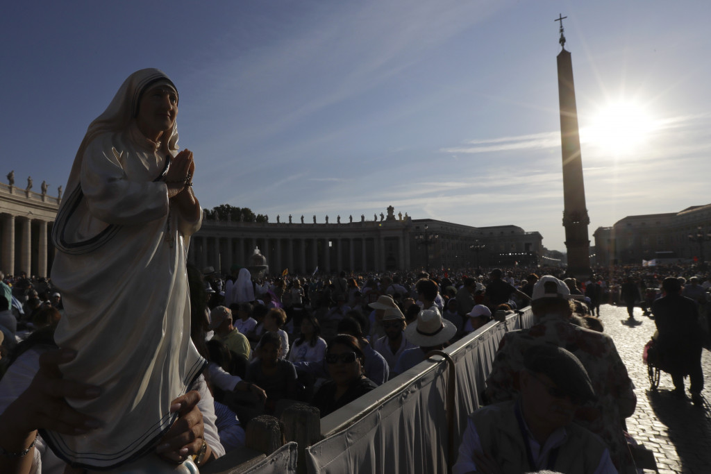 Irma Escuero of New York holds a statue of Mother Teresa before her canonization Mass in St. Peter's Square at the Vatican on Sunday.  Associated Press/Gregorio Borgia