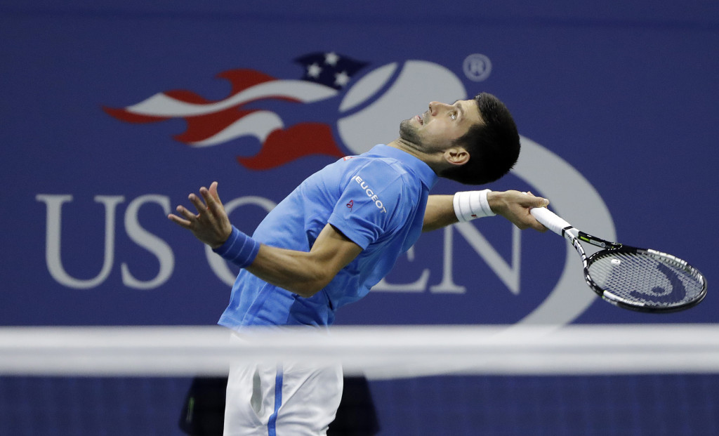 Novak Djokovic serves to Jo-Wilfried Tsonga during the quarterfinals of the U.S. Open on Tuesday.   Associated Press/Darron Cummings