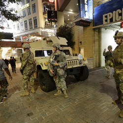 National Guardsmen stand watch on the street in downtown Charlotte, N.C. ,on Thursday.