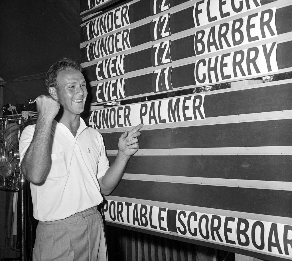 Arnold Palmer points to his name on the scoreboard showing his 4-under-par total at the U.S. Open in 1960.    Associated Press