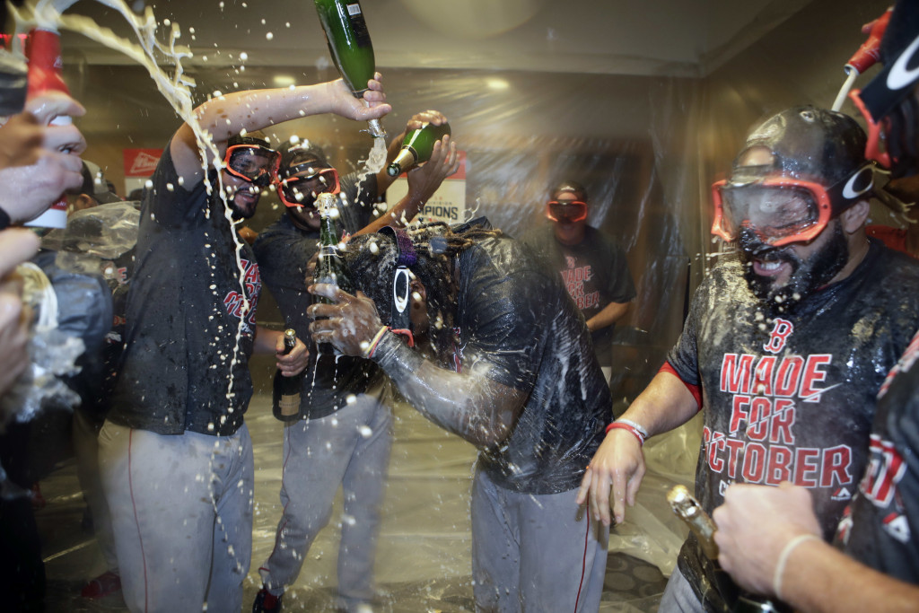 It's time for champagne as the Red Sox celebrate winning the AL East in their locker room after losing to the Yankees. Associated Press/Frank Franklin II