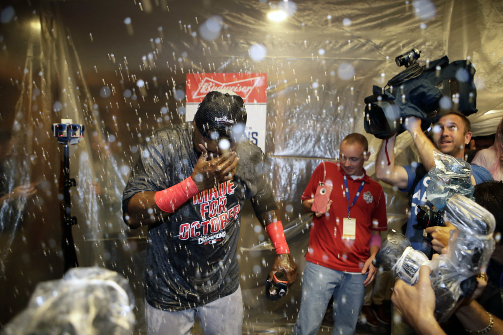 Boston Red Sox designated hitter David Ortiz covers his eyes as he celebrates with teammates after clinching the American League Eastern Division after a baseball game against the New York Yankees Wednesday, Sept. 28, 2016, in New York. (AP Photo/Frank Franklin II)