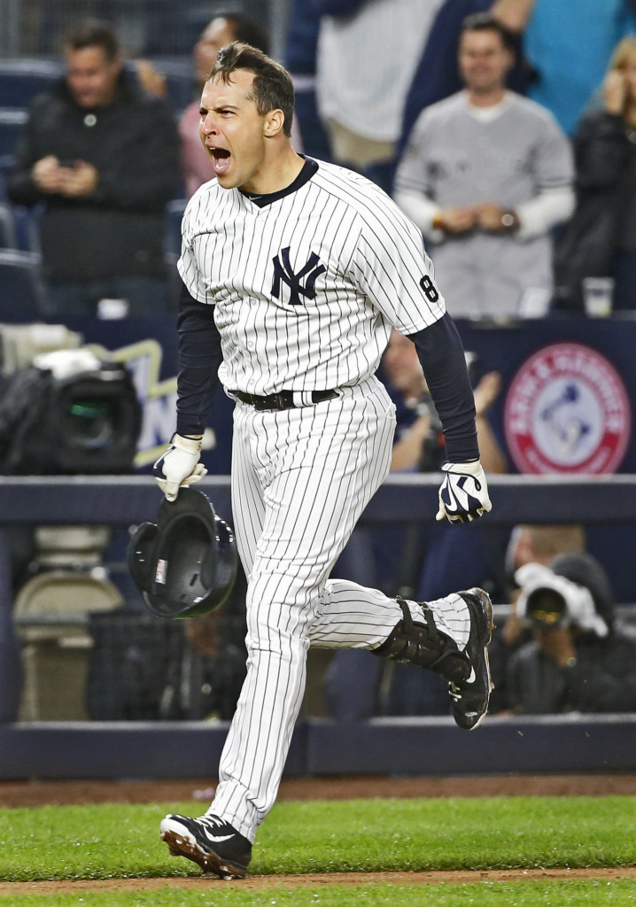 New York's Mark Teixeira reacts after hitting a ninth-inning, walk-off grand slam. Associated Press/Kathy Willens)