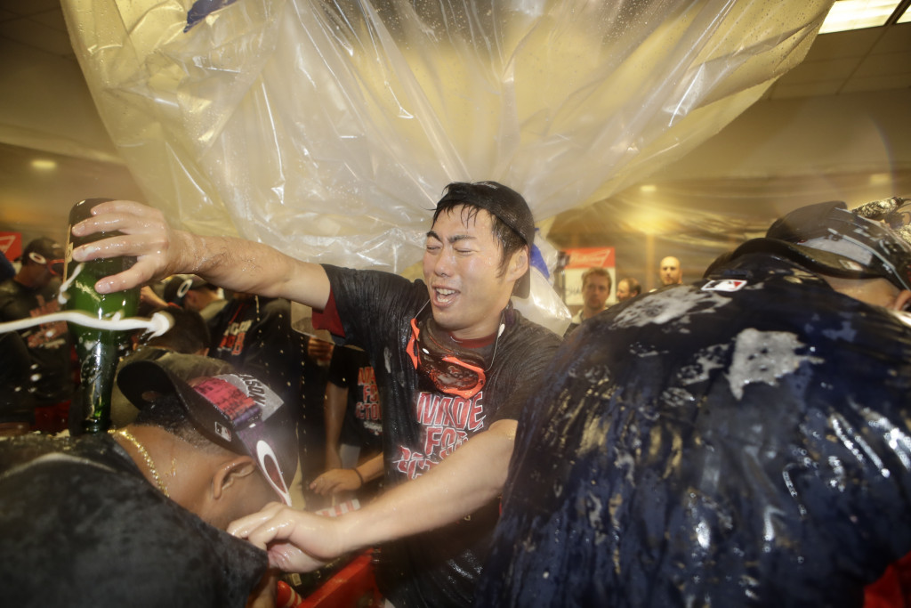 Boston Red Sox relief pitcher Koji Uehara, of Japan, celebrates after the Red Sox clinched the AL East title, following a baseball game against the New York Yankees on Wednesday, Sept. 28, 2016, in New York. (AP Photo/Frank Franklin II)