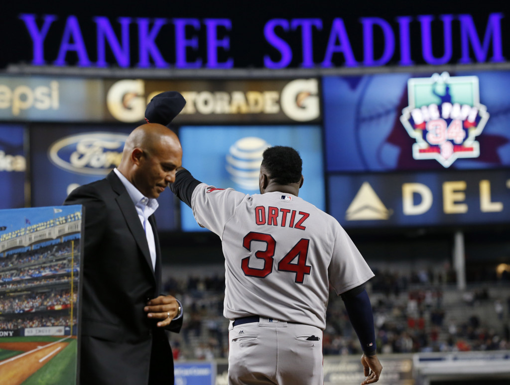 David Ortiz waves his cap to the crowd as retired Yankees pitcher Mariano Rivera, left, walks away as Ortiz was honored before Thursday's game at New York. Associated Press/Kathy Willens