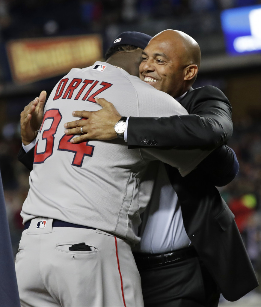 David Ortiz is greeted by former Yankees closer Mariano Rivera as Ortiz is honored before Thursday night's game in New York. Associated Press/Frank Franklin II